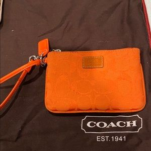 Coach orange monogram wristlet